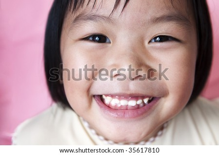 Asian girl. Close-up shot of a young Asian girl with smile on her face.