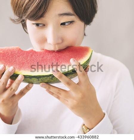 Asian Girl Eating Watermelon Fruit Sweet Dessert Concept - stock photo