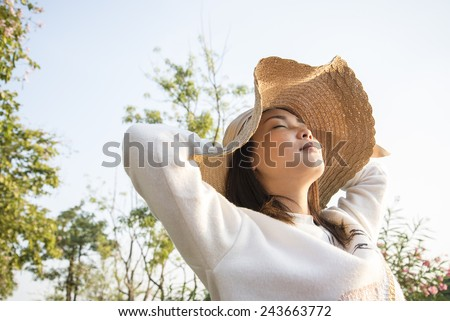 Asian girl feeling happy when sunset - stock photo