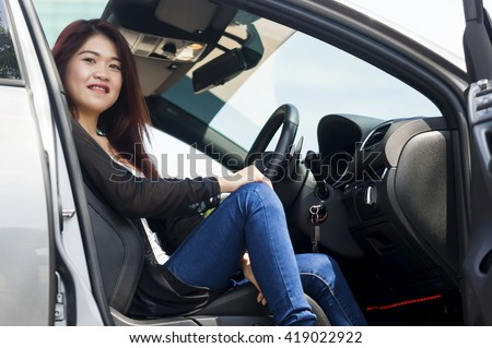 Asian Girl happy smiling in a car - stock photo