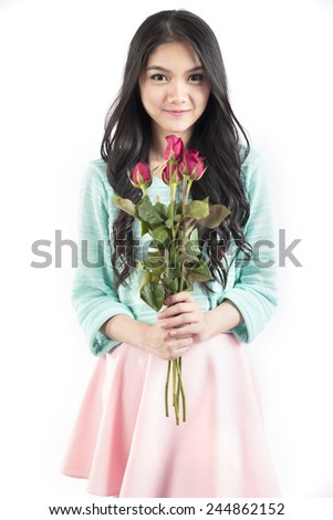 asian girl holding a bouquet of red roses celebrating Valentine day isolated on white background - stock photo