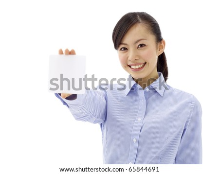 Asian girl holding a white card. Isolated on white background