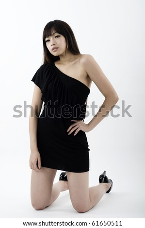 Asian girl in black clubbing dress - stock photo
