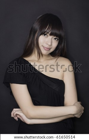 Asian girl in black clubbing dress thinking - stock photo