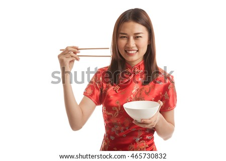 Asian girl in chinese cheongsam dress with  chopsticks   isolated on white background.