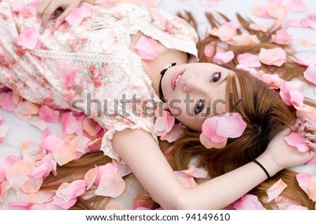 asian girl in flowers - stock photo