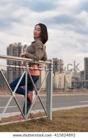 Asian girl in the city - stock photo