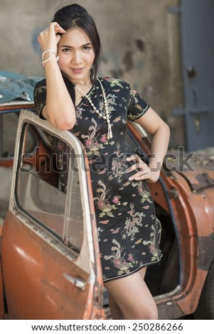 asian girl in traditional Chinese cheongsam  - stock photo