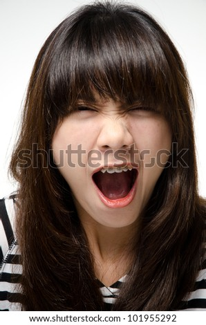 Asian girl is screaming - stock photo