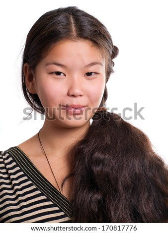 Asian girl looking on camera against white background - stock photo