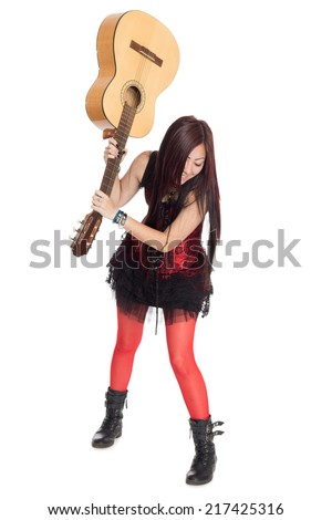 Asian girl musician is going to break the guitar.