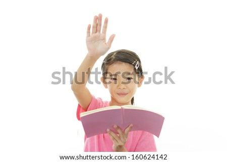 Asian girl reading her book - stock photo