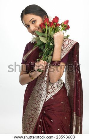 Asian girl red silk sari with bunch of red roses - stock photo