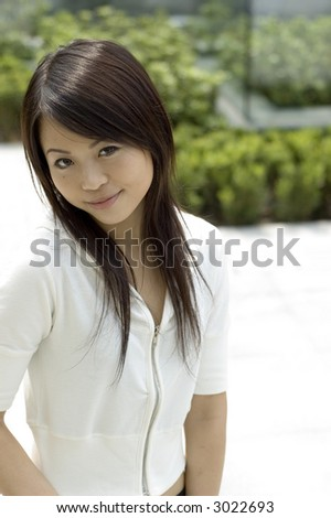 Asian girl smiling shyly to camera