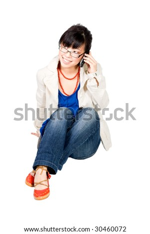 Asian girl speakin on cell phone wearing glasses and smiling - stock photo