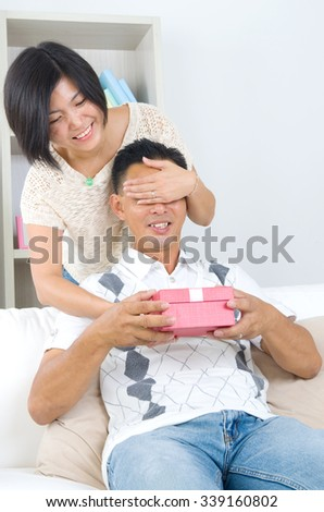 Asian girl surprises his boyfriend with a gift