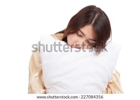 Asian girl  wake up  sleepy and drowsy with pillow  isolated on white background