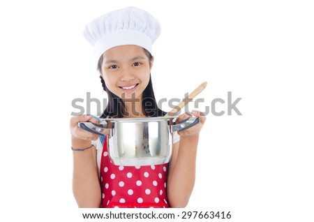 Asian girl wearing apron and holding a cooking pot - stock photo