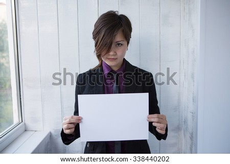 Asian girl with a white sheet of paper