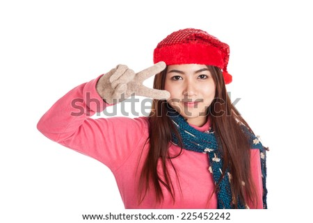 Asian girl with red christmas hat show victory sign  isolated on white background