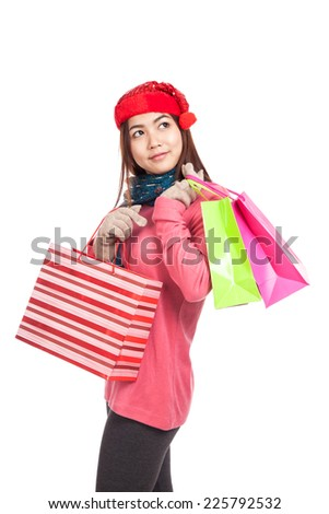 Asian girl with red christmas hat with shopping bags  isolated on white background