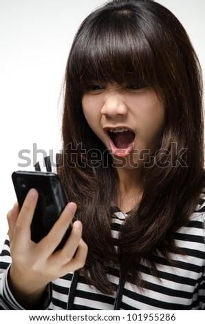 Asian girl yells at the black smartphone - stock photo