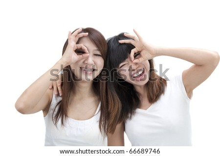 asian girls friend having fun and making funny faces - stock photo