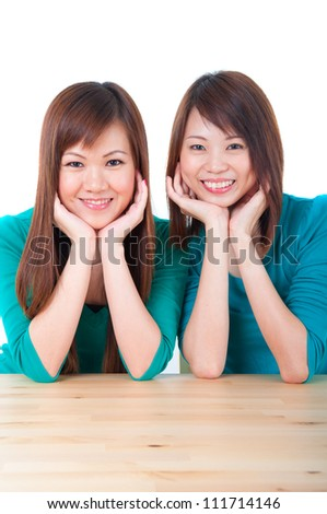 asian girls on a table - stock photo