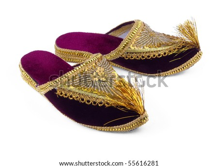 Asian gold embroidered shoes isolated on white