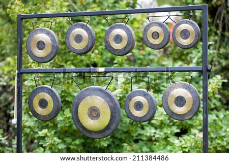 Asian gongs hanging in a frame - stock photo