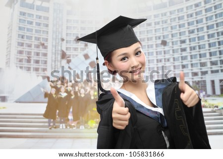asian graduate with big thumb - stock photo