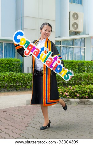Asian graduation women smile with congratulation sign - stock photo