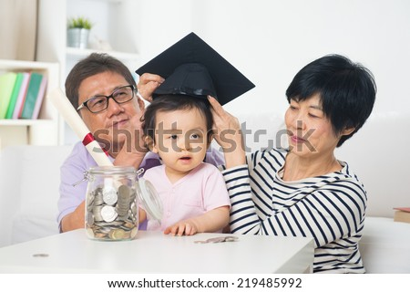 asian grand parents with grand daugther education saving concepts - stock photo