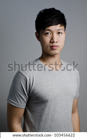 Asian guy on gray background - stock photo