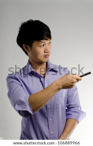 Asian guy point a pen to the side for presenting something