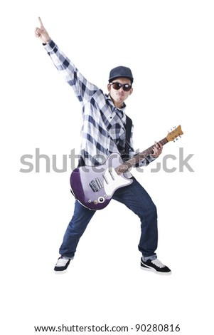 Asian guy with sun glasses plays with his electric guitar - stock photo