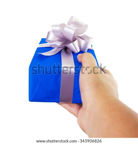 Asian hand gesture giving a gift wrapped in blue box with silver ribbon and bow in a first person view. the most beautiful gift isolated on white background - stock photo