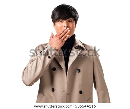 Asian handsome man making surprise gesture