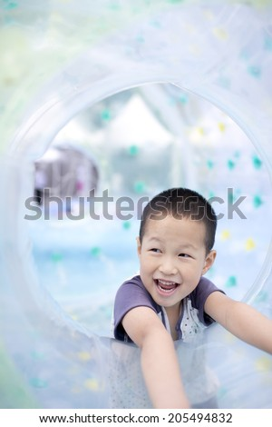 Asian happy boy playing in big air balloon