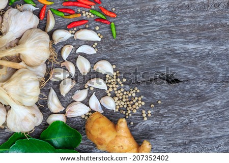 Asian hot and spicy Thai food ingredient on woooden background - stock photo
