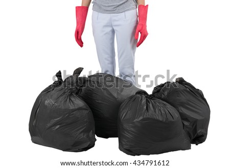 Asian housewife standing with garbage bags, isolated on white background. - stock photo