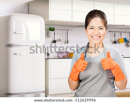 asian housewife wearing rubber gloves thumbs up
