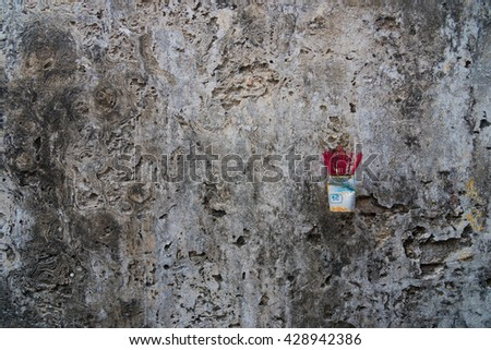 Asian incense on a dark wall - stock photo