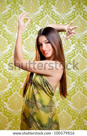 Asian Indian brunette girl with long hair dancing with hands up - stock photo