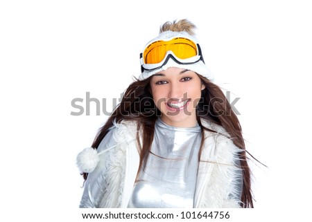asian indian brunette winter girl with snow fur cap and ski glasses - stock photo
