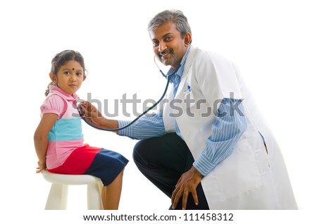 asian indian doctor with a young girl,medical check - stock photo