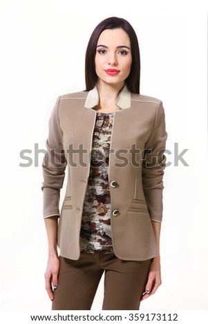 asian indian fashion model in khaki military print  blouse jacket and casual trousers close up portrait isolated on white - stock photo
