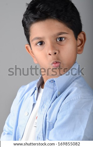 Asian indian kid with wow face. - stock photo