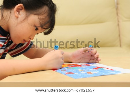 Asian kid painting at home - stock photo