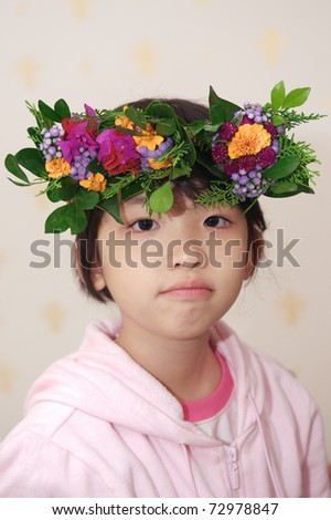 Asian kid with wreath on head - stock photo